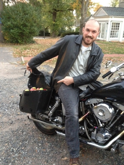 MCFC Member fills up his saddlebags on his motorcycle with his CSA produce.