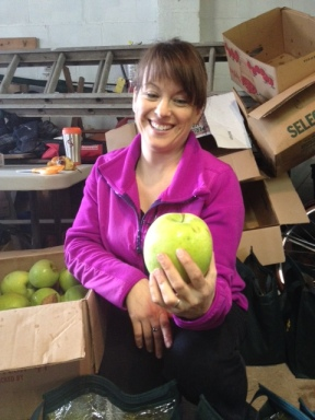 CSA Core member holds a giant Mutsu apple from Hepworth Farms!