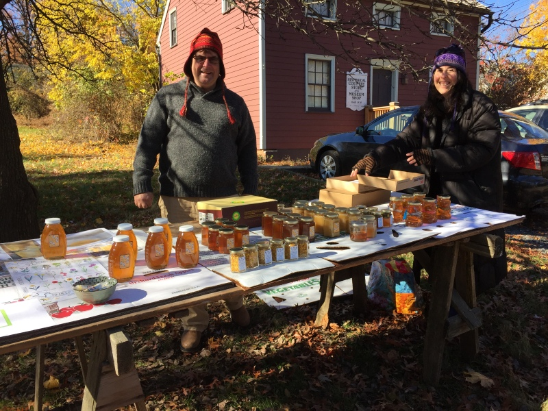 Jeff and Michele from Bee My Honey Apiary with a full table of sweetness